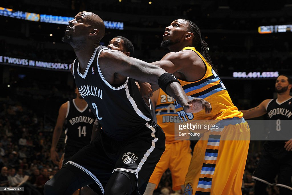 Kevin Garnett #2 of the Brooklyn Nets and Kenneth Faried #35 of the Denver Nuggets box out for a rebound during a game on February 27, 2014 at the Pepsi Center in Denver, Colorado.
