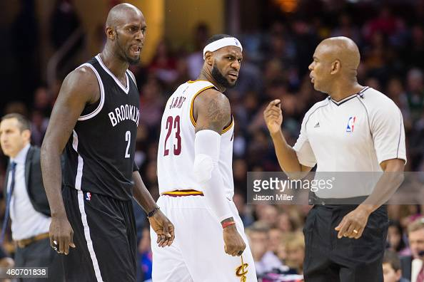 Kevin Garnett of the Brooklyn Nets and LeBron James of the Cleveland Cavaliers yell at official Sean Wright during the second half at Quicken Loans...