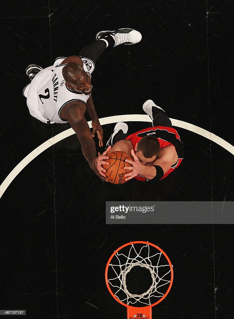 Kevin Garnett #2 of the Brooklyn Nets battles Jonas Valanciunas #17 of the Toronto Raptors for a rebound in Game Four of the Eastern Conference Quarterfinals during the 2014 NBA Playoffs at the Barclays Center on April 27, 2014 in the Brooklyn borough of New York City.
