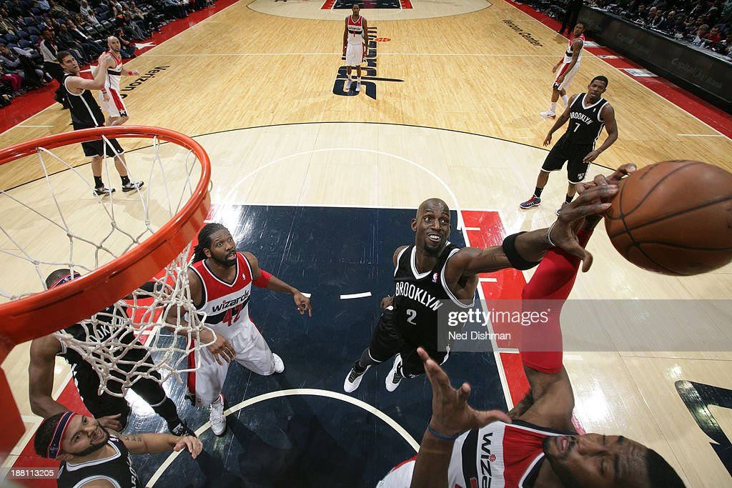<a gi-track='captionPersonalityLinkClicked' href=/galleries/search?phrase=Kevin+Garnett&family=editorial&specificpeople=201473 ng-click='$event.stopPropagation()'>Kevin Garnett</a> #2 of the Brooklyn Nets blocks a shot against the Washington Wizards at the Verizon Center on November 8, 2013 in Washington, DC.