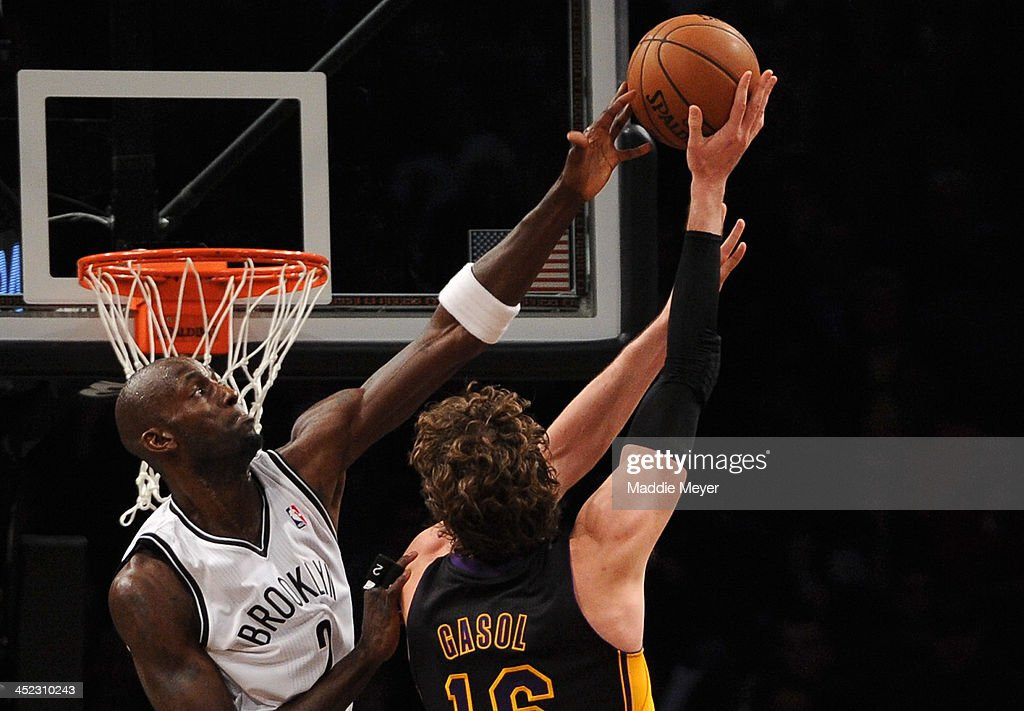 <a gi-track='captionPersonalityLinkClicked' href=/galleries/search?phrase=Kevin+Garnett&family=editorial&specificpeople=201473 ng-click='$event.stopPropagation()'>Kevin Garnett</a> #2 of the Brooklyn Nets blocks a shot by <a gi-track='captionPersonalityLinkClicked' href=/galleries/search?phrase=Pau+Gasol&family=editorial&specificpeople=201587 ng-click='$event.stopPropagation()'>Pau Gasol</a> #16 of the Los Angeles Lakers during the second half at Barclays Center on November 27, 2013 in the Brooklyn borough of New York City. The Lakers defeat the Nets 99-94.