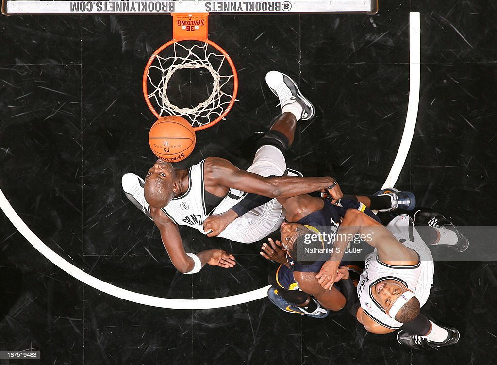 Kevin Garnett #2 of the Brooklyn Nets boxes out Roy Hibbert #55 of the Indiana Pacers during a game at Barclays Center on November 9, 2013 in the Brooklyn borough of New York City.