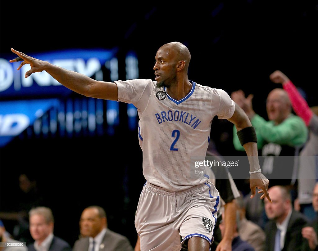 <a gi-track='captionPersonalityLinkClicked' href=/galleries/search?phrase=Kevin+Garnett&family=editorial&specificpeople=201473 ng-click='$event.stopPropagation()'>Kevin Garnett</a> #2 of the Brooklyn Nets celebrates a shot in the first half against the New York Knicks at the Barclays Center on February 6, 2015 in the Brooklyn borough of New York City.