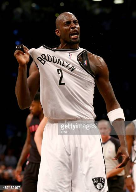 Kevin Garnett of the Brooklyn Nets celebrates after he recovered the ball in the first half against the Toronto Raptors in Game Three of the Eastern...
