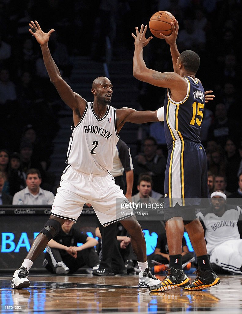 Kevin Garnett #2 of the Brooklyn Nets defends Derrick Favors #15 of the Utah Jazz during the first quarter at Barclays Center on November 5, 2013 in the Brooklyn borough of New York City.