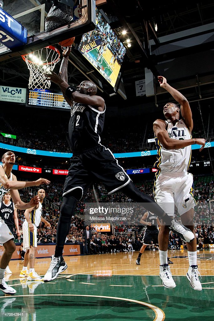 <a gi-track='captionPersonalityLinkClicked' href=/galleries/search?phrase=Kevin+Garnett&family=editorial&specificpeople=201473 ng-click='$event.stopPropagation()'>Kevin Garnett</a> #2 of the Brooklyn Nets dunks against Alec Burks #10 of the Utah Jazz at EnergySolutions Arena on February 19, 2014 in Salt Lake City, Utah.