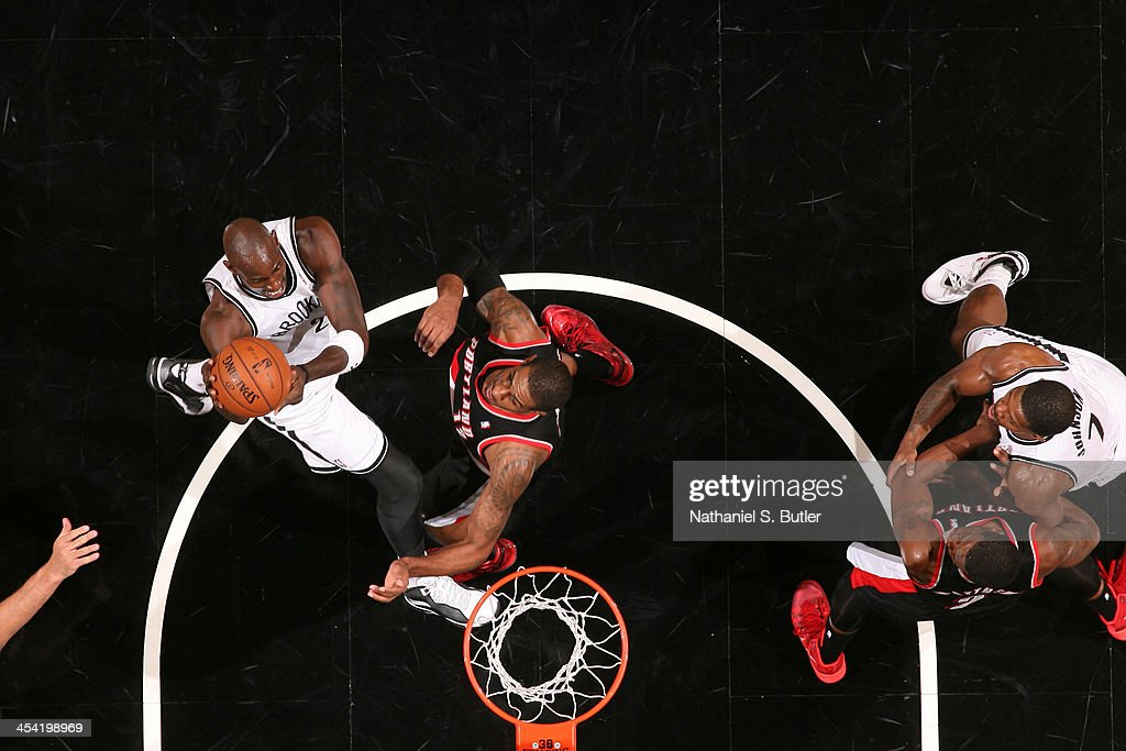 <a gi-track='captionPersonalityLinkClicked' href=/galleries/search?phrase=Kevin+Garnett&family=editorial&specificpeople=201473 ng-click='$event.stopPropagation()'>Kevin Garnett</a> #2 of the Brooklyn Nets goes to the basket against <a gi-track='captionPersonalityLinkClicked' href=/galleries/search?phrase=LaMarcus+Aldridge&family=editorial&specificpeople=453277 ng-click='$event.stopPropagation()'>LaMarcus Aldridge</a> #12 of the Portland Trail Blazers at Barclays Center on November 18, 2013 in the Brooklyn borough of New York City.