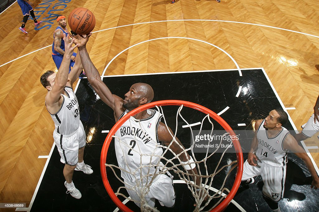 Kevin Garnett #2 of the Brooklyn Nets goes up for a rebound during a game against the New York Knicks at Barclays Center on December 5, 2013 in the Brooklyn borough of New York City.