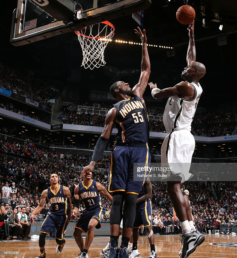 Kevin Garnett #2 of the Brooklyn Nets goes up to shoot against Roy Hibbert #55 of the Indiana Pacers during a game at Barclays Center on November 9, 2013 in the Brooklyn borough of New York City.