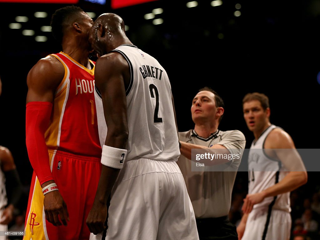 <a gi-track='captionPersonalityLinkClicked' href=/galleries/search?phrase=Kevin+Garnett&family=editorial&specificpeople=201473 ng-click='$event.stopPropagation()'>Kevin Garnett</a> #2 of the Brooklyn Nets head butts <a gi-track='captionPersonalityLinkClicked' href=/galleries/search?phrase=Dwight+Howard&family=editorial&specificpeople=201570 ng-click='$event.stopPropagation()'>Dwight Howard</a> #12 of the Houston Rockets in the first quarter after the two were in a shoving match at the Barclays Center on January 12, 2015 in the Brooklyn borough of New York City.