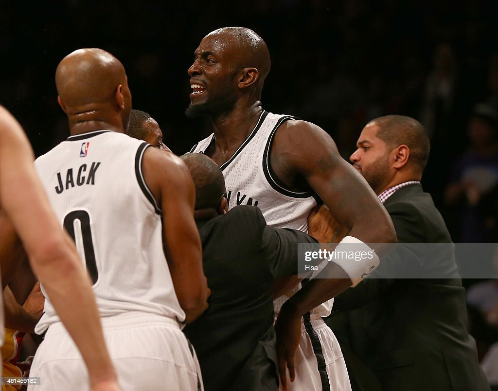 Kevin Garnett of the Brooklyn Nets is held back as he and Dwight Howard of the Houston Rockets get into a fight at the Barclays Center on January 12...
