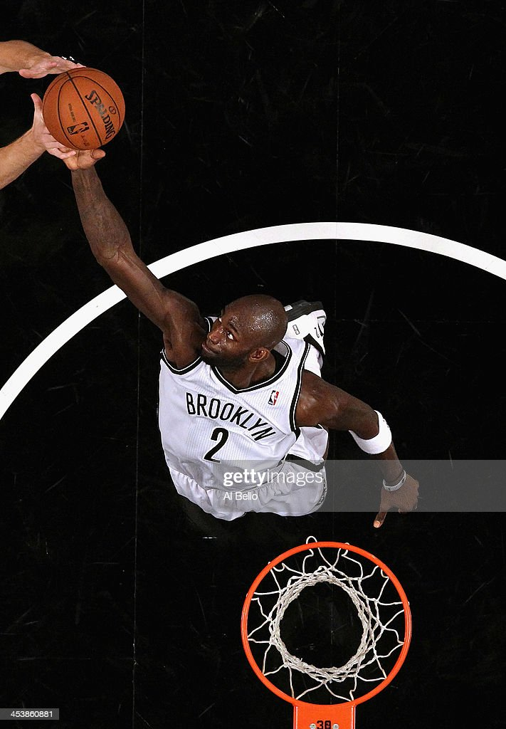 Kevin Garnett #2 of the Brooklyn Nets reaches for a rebound against the New York Knicks during their game at the Barclays Center on December 5, 2013 in the Brooklyn borough of New York City.