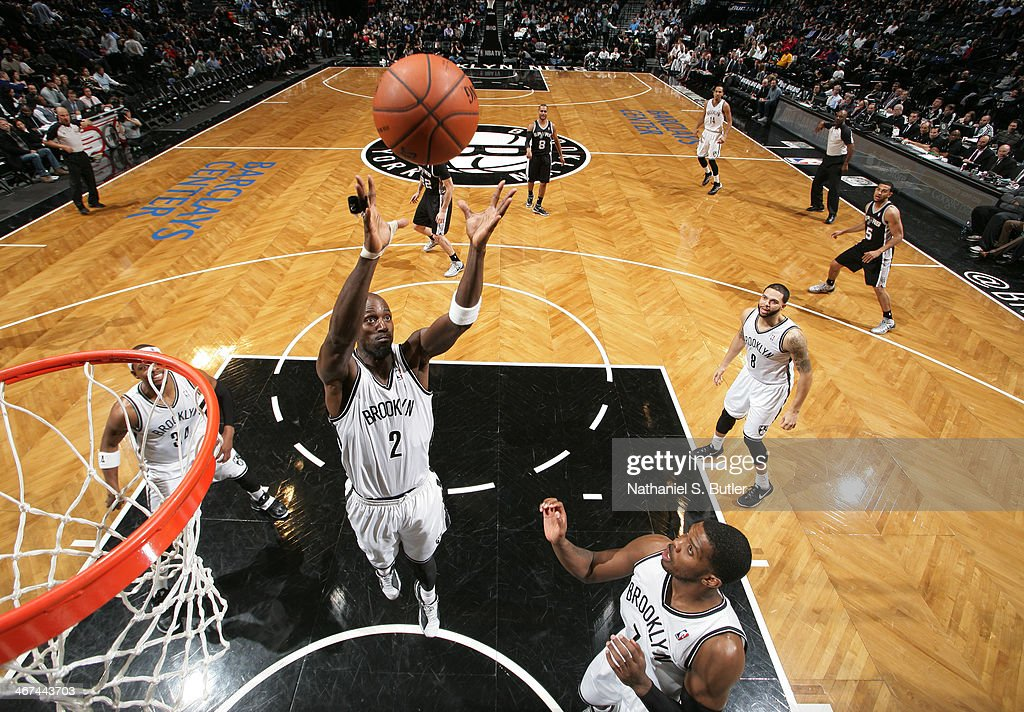 <a gi-track='captionPersonalityLinkClicked' href=/galleries/search?phrase=Kevin+Garnett&family=editorial&specificpeople=201473 ng-click='$event.stopPropagation()'>Kevin Garnett</a> #2 of the Brooklyn Nets rebounds during a game against the San Antonio Spurs at the Barclays Center on February 06, 2014 in the Brooklyn borough of New York City.