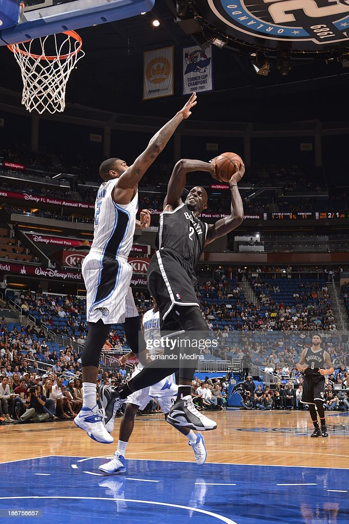 <a gi-track='captionPersonalityLinkClicked' href=/galleries/search?phrase=Kevin+Garnett&family=editorial&specificpeople=201473 ng-click='$event.stopPropagation()'>Kevin Garnett</a> #2 of the Brooklyn Nets shoots against <a gi-track='captionPersonalityLinkClicked' href=/galleries/search?phrase=Kyle+O%27Quinn&family=editorial&specificpeople=9027719 ng-click='$event.stopPropagation()'>Kyle O'Quinn</a> #2 of the Orlando Magic on November 3, 2013 at Amway Center in Orlando, Florida.