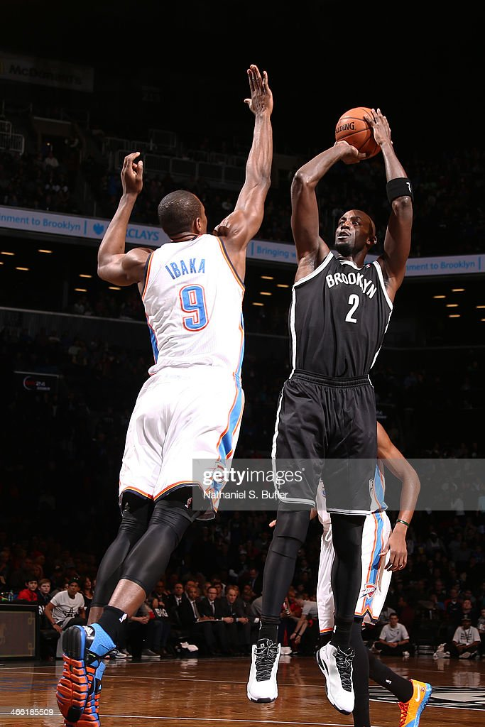 Kevin Garnett #2 of the Brooklyn Nets shoots against Serge Ibaka #9 of the Oklahoma City Thunder at the Barclays Center on January 31, 2014 in the Brooklyn borough of New York City.