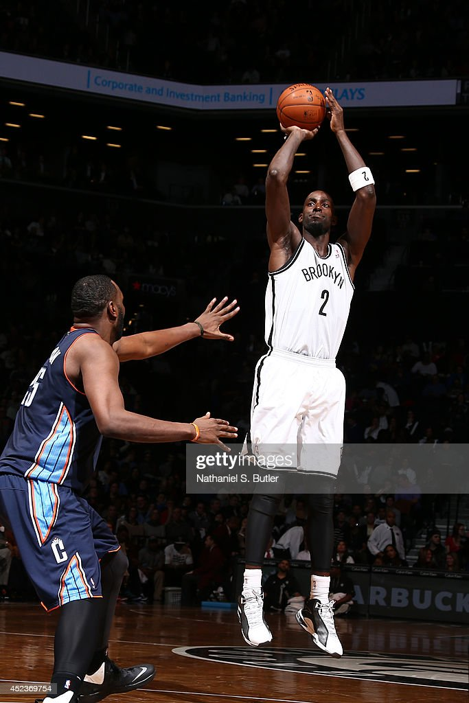<a gi-track='captionPersonalityLinkClicked' href=/galleries/search?phrase=Kevin+Garnett&family=editorial&specificpeople=201473 ng-click='$event.stopPropagation()'>Kevin Garnett</a> #2 of the Brooklyn Nets shoots against the Charlotte Bobcats at the Barclays Center on February 12, 2014 in the Brooklyn borough of New York City.