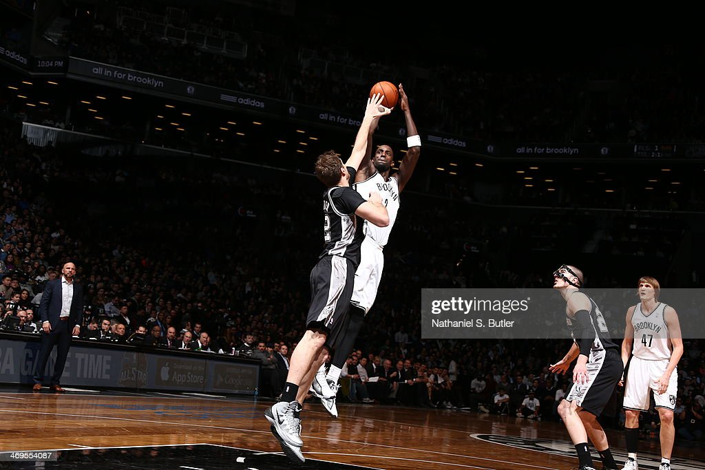 <a gi-track='captionPersonalityLinkClicked' href=/galleries/search?phrase=Kevin+Garnett&family=editorial&specificpeople=201473 ng-click='$event.stopPropagation()'>Kevin Garnett</a> #2 of the Brooklyn Nets shoots against the San Antonio Spurs at the Barclays Center on February 06, 2014 in the Brooklyn borough of New York City.
