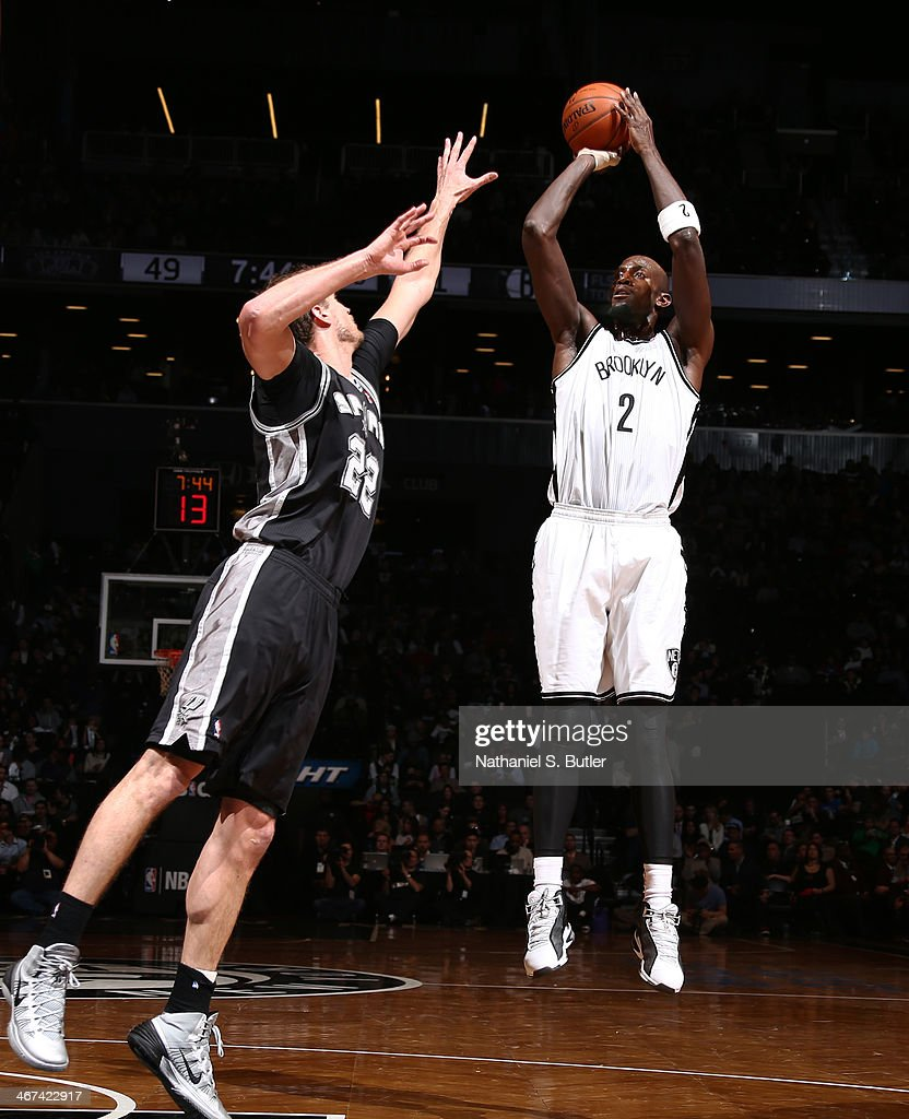 Kevin Garnett #2 of the Brooklyn Nets shoots against Tiago Splitter #22 of the San Antonio Spurs during a game at the Barclays Center on February 06, 2014 in the Brooklyn borough of New York City.