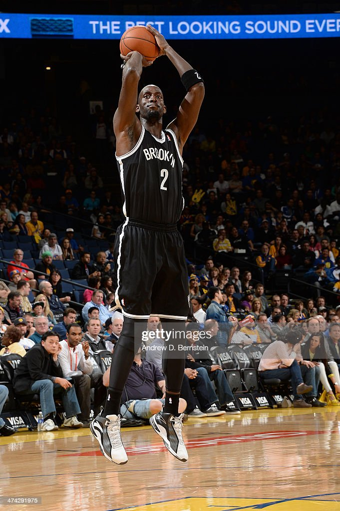 Kevin Garnett #2 of the Brooklyn Nets shoots during a game against the Golden State Warriors at Oracle Arena on February 22, 2014 in Oakland, California.