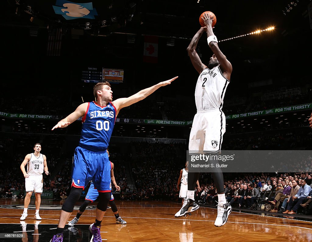 Kevin Garnett #2 of the Brooklyn Nets shoots over Spencer Hawes #00 of the Philadelphia 76ers during a game at Barclays Center in Brooklyn.