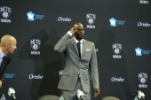 Kevin Garnett of the Brooklyn Nets speaks to reporters during a press conference at the Barclays Center on July 18 2013 in the Brooklyn borough of...