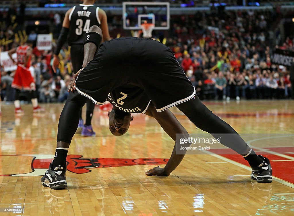 Kevin Garnett #2 of the Brooklyn Nets stretches before entering a game against the Chicago Bulls at the United Center on February 13, 2014 in Chicago, Illinois. The Bulls defeated the Nets 92-76.