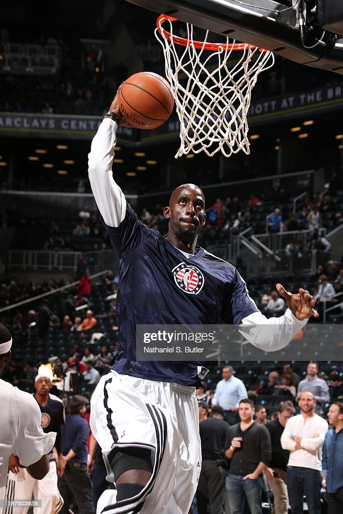 Kevin Garnett #2 of the Brooklyn Nets warms up in a special NBA shirt that celebrates Veterans Day before playing the Indiana Pacers at Barclays Center on November 9, 2013 in the Brooklyn borough of New York City.