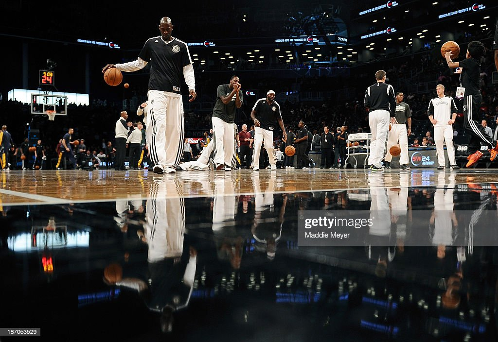 Kevin Garnett #2 of the Brooklyn Nets warms up with his teammates before the game against the Utah Jazz at Barclays Center on November 5, 2013 in the Brooklyn borough of New York City.