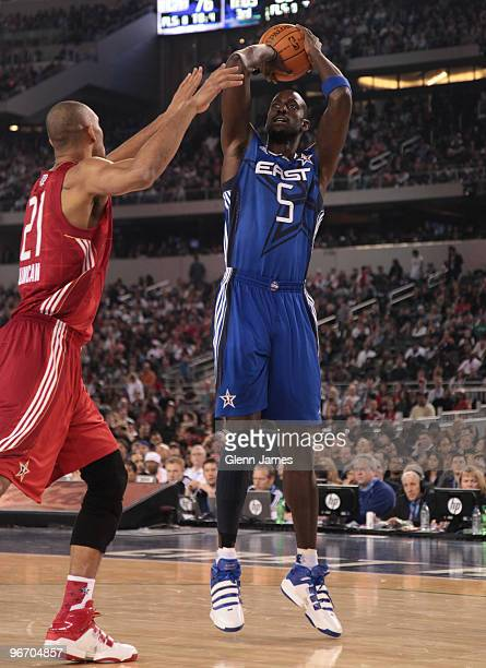 Kevin Garnett of the Eastern Conference shoots a jumper against Tim Duncan of the Western Conference during the NBA AllStar Game as part of the 2010...