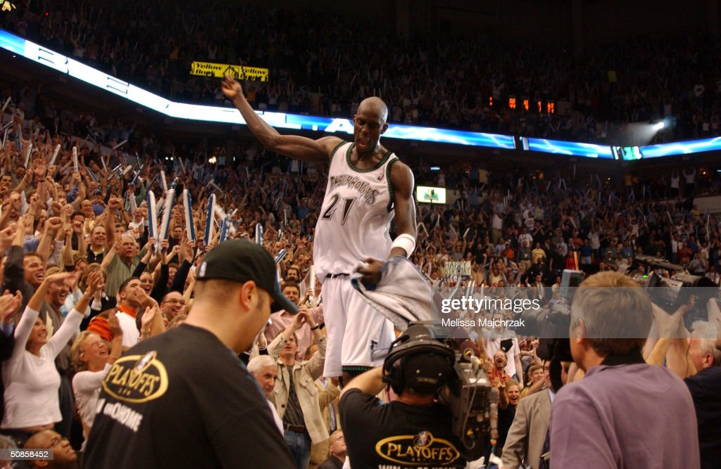 Kevin Garnett #21 of the Minnesota Timberwolves acknowledges the crowd after winning Game Seven against the Sacramento Kings in Game Seven of the Western Conference Semifinals during the 2004 NBA Playoffs at Target Center on May 19, 2004 in Minneapolis, Minnesota.