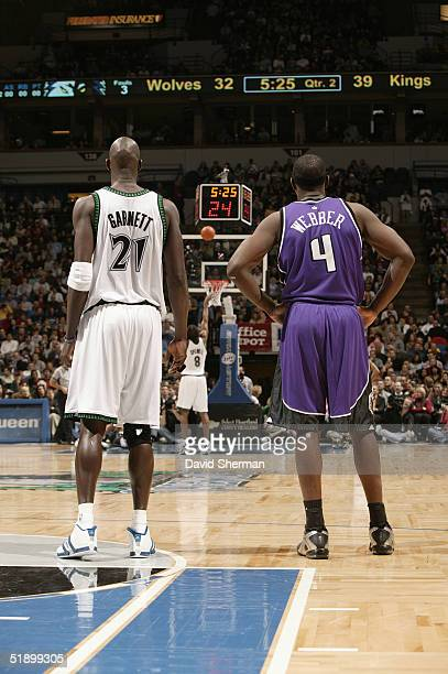 Kevin Garnett of the Minnesota Timberwolves and Chris Webber of the Sacramento Kings stand on the court during the game December 10 2004 at the...