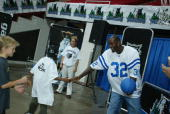 Kevin Garnett of the Minnesota Timberwolves congratulates a young fan after making a basket during the Timberwolves Fan Fair on October 27 2002 at...