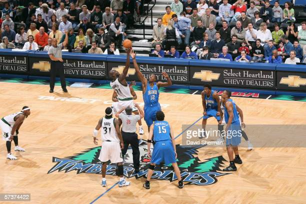 Kevin Garnett of the Minnesota Timberwolves goes up for the opening tip off against Dwight Howard of the Orlando Magic on March 29 2006 at the Target...