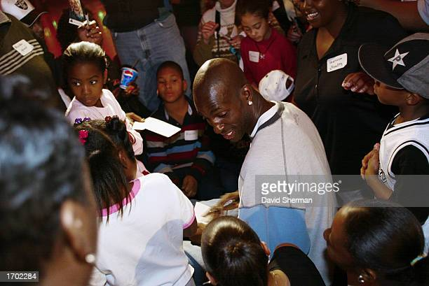 Kevin Garnett of the Minnesota Timberwolves signs autographs during the Timberwolves Holiday Party for Kids on December 15 2002 at the Roller Garden...