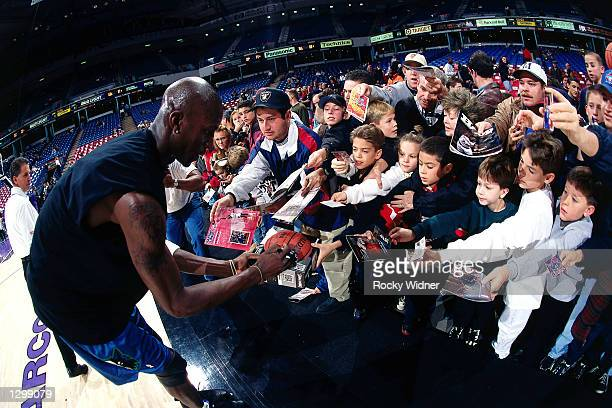 Kevin Garnett of the Minnesota Timberwolves signs some autographs after an NBA game at the Target Center in Minneapolis Minnesota NOTE TO USER User...