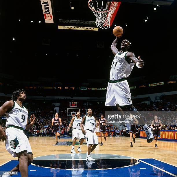 Kevin Garnett of the Minnesota Timberwolves soars for a dunk against the Memphis Grizzlies during a 2002 NBA game at the Target Center in Minneapolis...