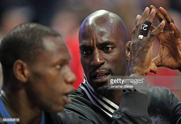 Kevin Garnett of the Minnesota Timberwolves talks with teammate Gorgui Dieng on the bench during a game against the Chicago Bulls at the United...