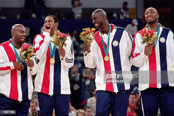 Kevin Garnett of the USA jokes with Vince Carter after they recieve their gold medal in the Mens Basketball Final against France on October 1 2000...