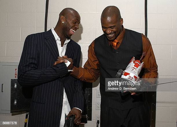 Kevin Garnett of the Western Conference greets SHaquille O'Neal of the Eastern Conference during the 2006 NBA AllStar Game February 19 2006 at the...