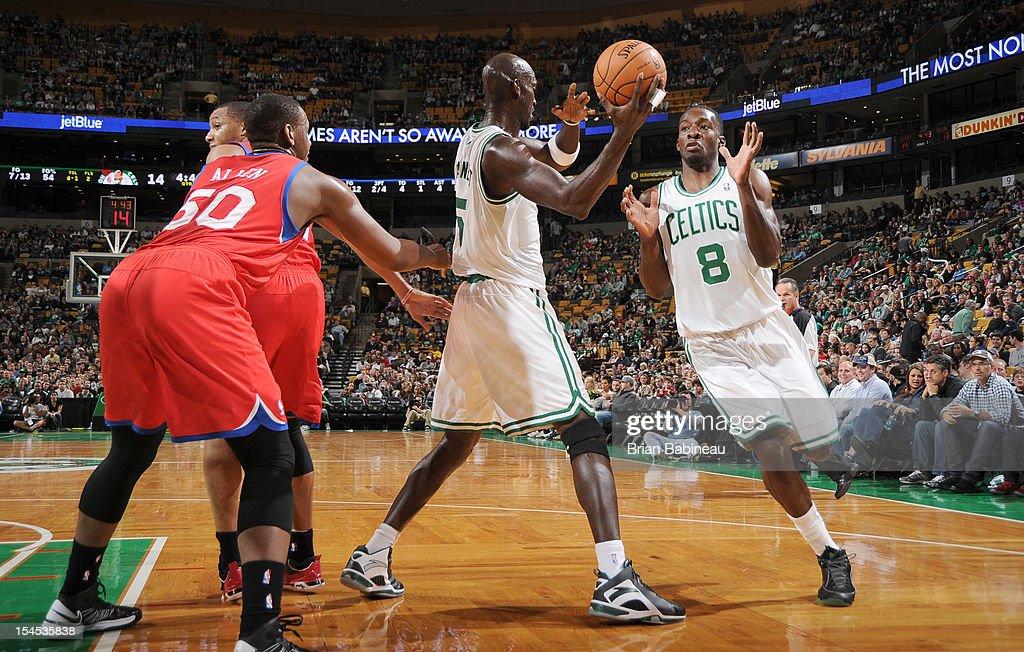 Kevin Garnett #5 passes the ball to teammate Jeff Green #8 of the Boston Celtics against the Philadelphia 76ers on October 21, 2012 at the TD Garden in Boston, Massachusetts.