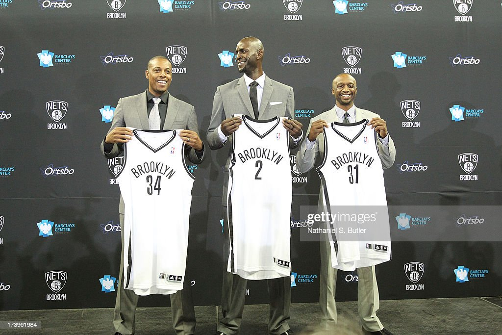<a gi-track='captionPersonalityLinkClicked' href=/galleries/search?phrase=Kevin+Garnett&family=editorial&specificpeople=201473 ng-click='$event.stopPropagation()'>Kevin Garnett</a> #2, <a gi-track='captionPersonalityLinkClicked' href=/galleries/search?phrase=Paul+Pierce&family=editorial&specificpeople=201562 ng-click='$event.stopPropagation()'>Paul Pierce</a> #34, and <a gi-track='captionPersonalityLinkClicked' href=/galleries/search?phrase=Jason+Terry&family=editorial&specificpeople=201734 ng-click='$event.stopPropagation()'>Jason Terry</a> #31 of the Brooklyn Nets pose with their new jerseys during a press conference at the Barclays Center on July 18, 2013 in the Brooklyn borough of New York City.