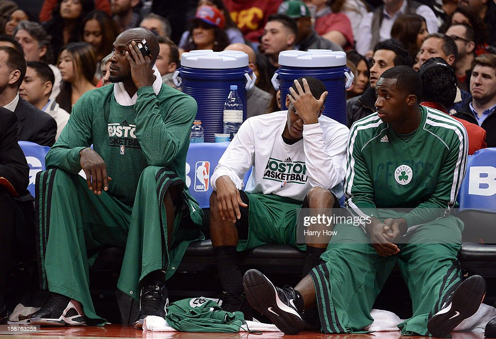 Kevin Garnett #5, Rajon Rondo #9 and Brandon Bass #30 of the Boston Celtics watch play from the bench during a 106-77 loss to the Los Angeles Clippers for their 15th straight win at Staples Center on December 27, 2012 in Los Angeles, California.