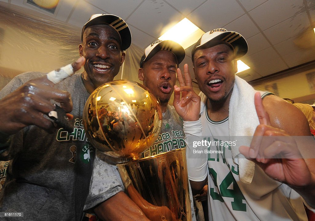 Kevin Garnett #5, <a gi-track='captionPersonalityLinkClicked' href=/galleries/search?phrase=Ray+Allen&family=editorial&specificpeople=201511 ng-click='$event.stopPropagation()'>Ray Allen</a> #20 and Paul Pierce #34 of the Boston Celtics pose for a photo with the NBA Champion trophy after defeating the Los Angeles Lakers during Game Six of the NBA Finals at the TD Banknorth Garden on June 17, 2008 in Boston, Massachusetts.
