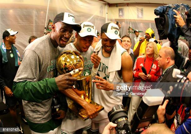 Kevin Garnett Ray Allen and Paul Pierce of the Boston Celtics celebrate with the Larry O'Brien championship trophy after defeating the Los Angeles...