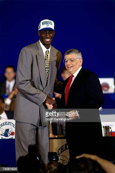 Kevin Garnett taken number five overall by the Minnesota Timberwolves shakes NBA Commissioner David Stern's hand during the 1995 NBA Draft on June 28...