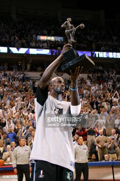 Kevin Garnett#21 of the Minnesota Timberwolves receives the NBA MVP award on May 4 2004 at the Target Center in Minneapolis Minnesota NOTE TO USER...