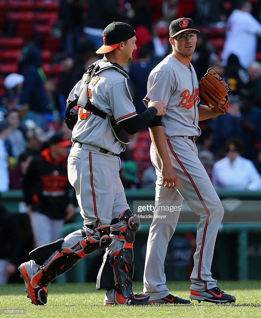 Kevin Gausman #39 of the Baltimore Orioles celebrates with Caleb Joseph #36 after the game against the Boston Red Sox at Fenway Park on April 19, 2015 in Boston, Massachusetts. The Orioles defeat the Red Sox 8-3.