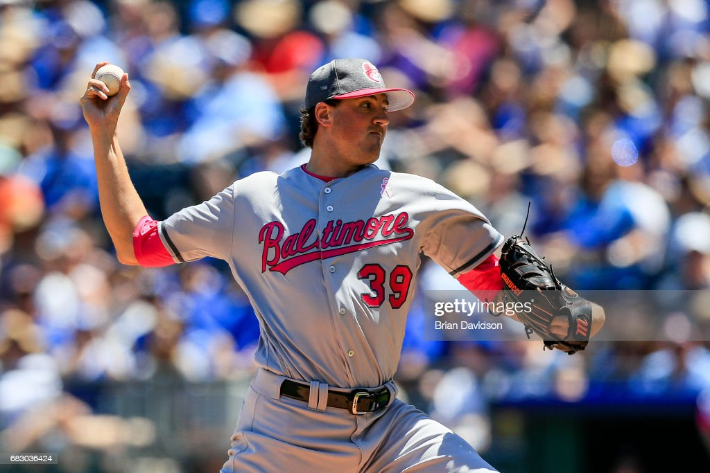 Kevin Gausman #39 of the Baltimore Orioles pitches against the Kansas City Royals during the first inning at Kauffman Stadium on May 14, 2017 in Kansas City, Missouri. Players are wearing pink to celebrate Mother's Day weekend and support breast cancer awareness.