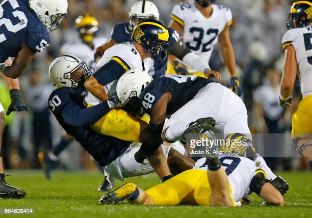 Kevin Givens and Shareef Miller of the Penn State Nittany Lions sack John O'Korn of the Michigan Wolverines in the second half on October 21 2017 at...