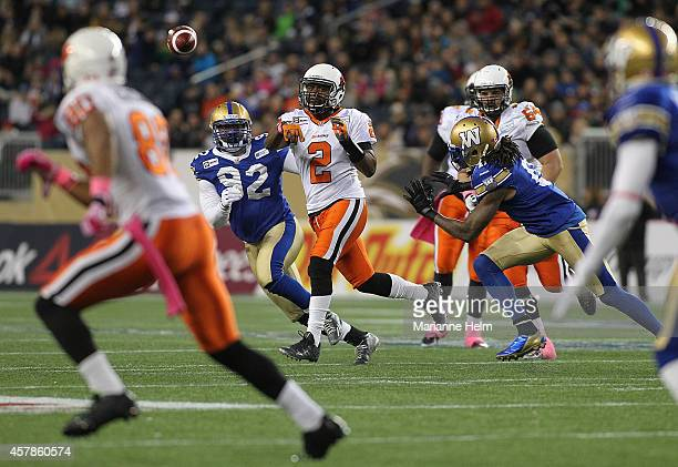 Kevin Glenn of the BC Lions gets rid of the ball under pressure in first half action in a CFL game against the Winnipeg Blue Bombers at Investors...